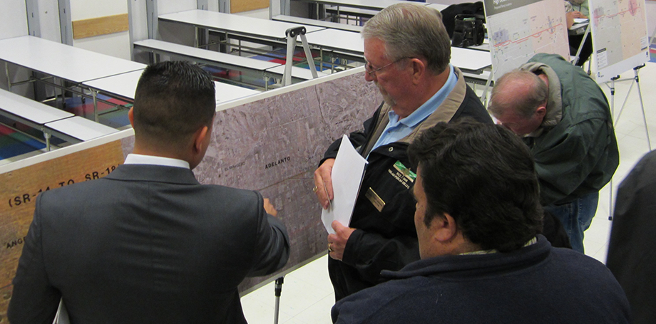 Metro's HDC Project Manager, Robert Machuca, responding to questions regarding Adelanto map during Open House.