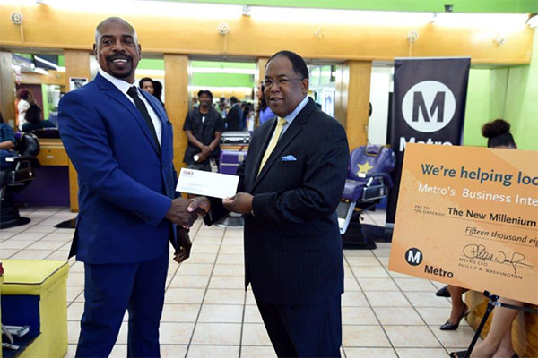 Metro Board Member and L.A. County Supervisor Mark Ridley-Thomas presenting the BIF grantee check to The New Millennium Beauty & Barber Shop owner Desentrie Allen.