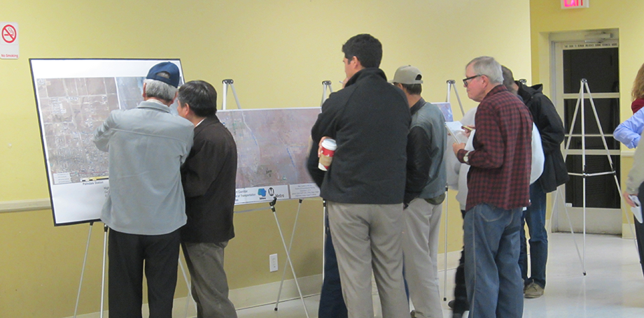 Community Members viewing project area maps during Open House.