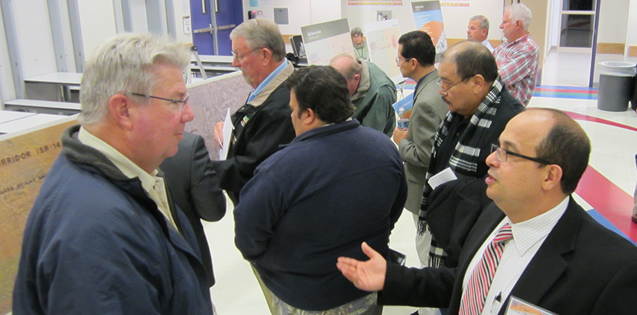 Caltrans Project Manager, Osama Megalla, responding to questions from community member during Open House.