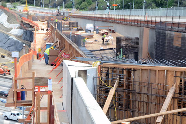 <p>Looking east, this photo captures another angle of abutment 1. The rebar cages at the center of the photo will support the bridge deck.</p>