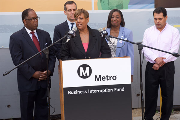 BIF Grantee Marilyn Brown owner of Design Studio 27 speaks at the Business Interruption Fund Launch event on April 6, 2015.