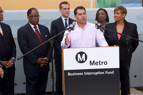 BIF Grantee Gilbert Carrillo owner 1st Choice Driving and Traffic School speaks at the Business Interruption Fund Launch event on April 6, 2015.