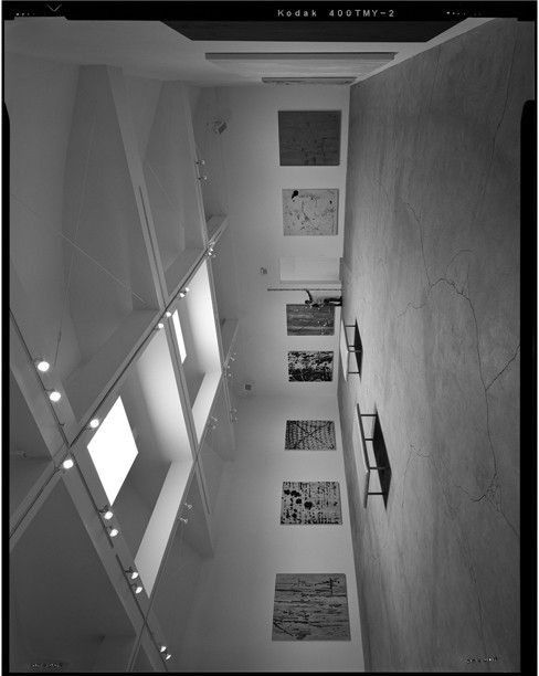 <p>Interior oblique overview of main gallery volume in center of building with human and 12&prime; scale marked in tenths. Camera height 5&prime;, facing north-northwest.</p>
