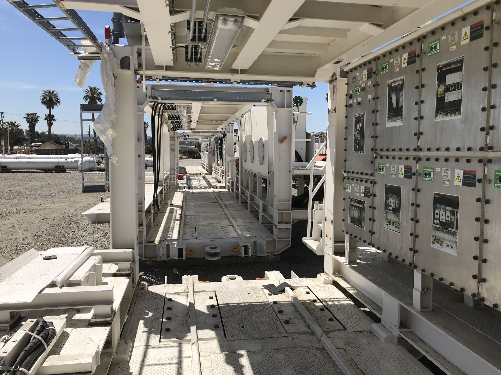 Tunnel boring machine component waiting assembly inside Wilshire/La Brea staging yard (May 2018)