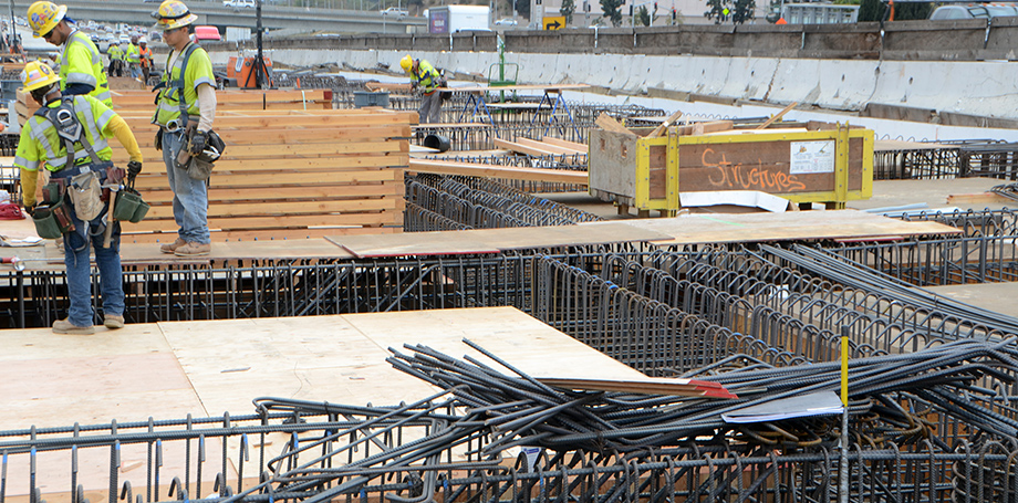 Workers are completing the elaborate rebar structures that must be finished before the bridge deck can be poured. This photo looks southwest.