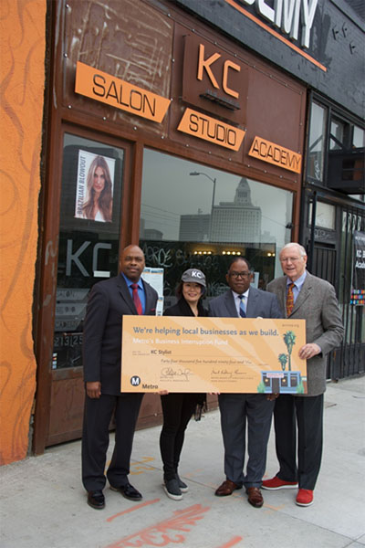 KC Stylist Owners Yuko Koach poses for a photo with Metro CEO Phil Washington, Metro Board Member and L.A. County Supervisor Mark Ridley-Thomas and Metro Board Member and L.A. County Supervisor Michae