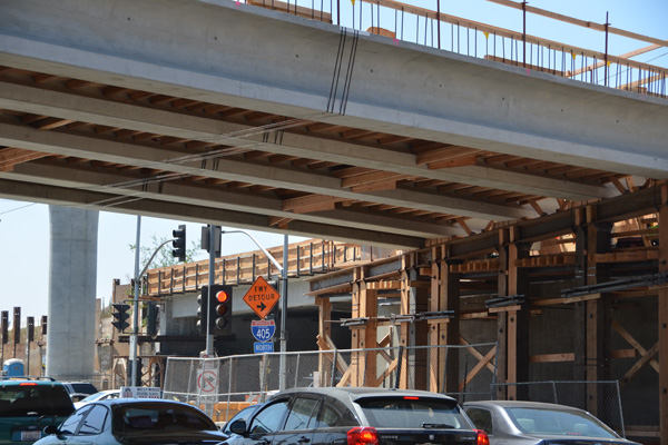 This photo was taken looking southwest with Sepulveda Bl in the foreground. Here are the girders for the northbound off-ramp to westbound Wilshire, also known as Bridge 10.