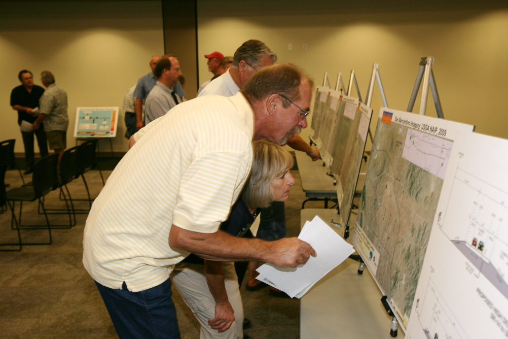 """<p class=""""MsoNormal"""">Community members reviewing the project maps.</p>"""
